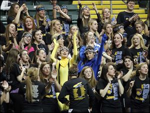 St. Ursula Academy fans cheer their team.