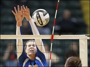 St. Ursula Academy player Maddie Burnham, 19, blocks the shot of Cincinnati Ursuline player Rachel Garnett.