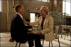 "Daniel Craig, left, and Javier Bardem in a scene from the film ""Skyfall."" Bardem portrays, Raoul Silva, one of the finest arch-enemies in the 50-year history of Bond films."
