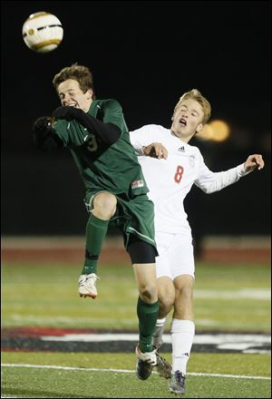 Ottawa Hills' Dan Reilly (3) moves the ball against  Gates Mills Hawken's Patrick Connors during a  Division III boys state soccer semifinal Wednesday in Sandusky, Ohio.