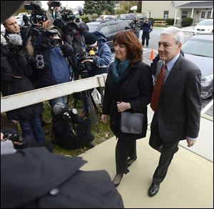 Former Penn State University President Graham Spanier and his wife Sandra enter Harrisburg, Pa. District Judge William Wenner's office Wednesday.