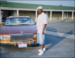 A young Wayne Banks, Jr., stands next to his Cadillac outside a motel. Banks made his fi rst 'pimp dollar' at the age of 16, using a prostitute who was about 20.