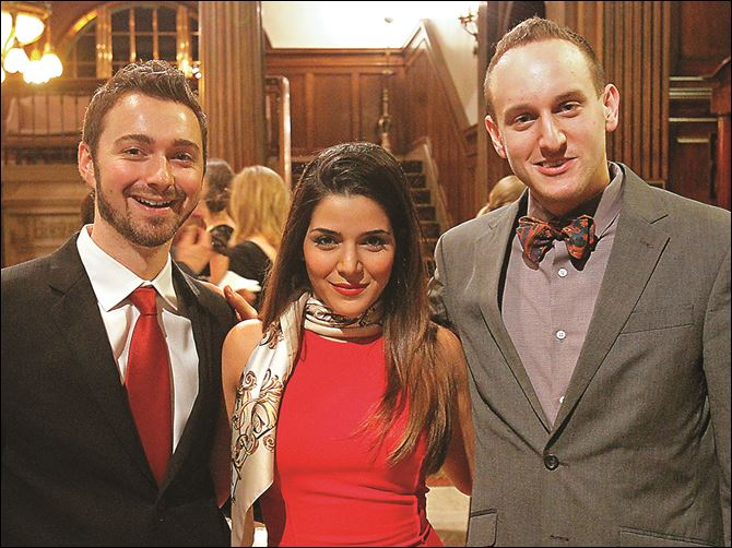 From left, Joshua Cooper, Negar Cooper From left, Joshua Cooper, Negar Cooper, center, and Tim Hanson, right, pose for a photograph Friday evening during the Sapphire Blues to Benefit the Toledo Opera at the Toledo Club in Toledo.