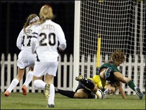 Perrysburg goalie Chloe Buehler (1) defends the net against  Mason's Madison Melnick (1).