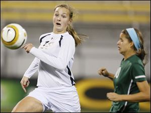 Perrysburg's Alexx Brown (18) chases the ball against  Mason's Olivia Gaus (10).