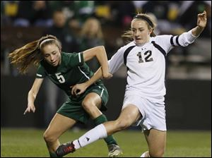Perrysburg's Maddy Williams (12) is fouled by Mason's Chloe Knue (5).