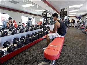 A customer works out at Snap Fitness Rolling Strong Gym at a truck stop in Dallas. In addition to fitness centers, some programs are mapping out exercise routes at truck stops and fast food restaurants are offering tips on how to spot healthy menu items.