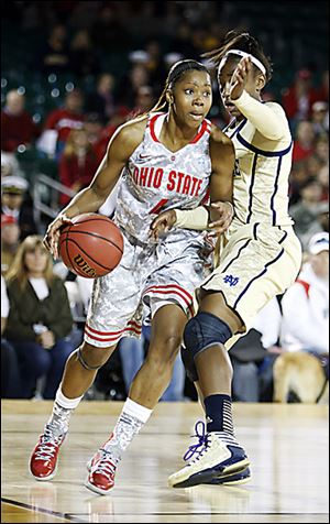Ohio State's Tayler Hill, left, drives around Notre Dame's Jewell Loyd during the second half of an NCAA college basketball game in the Carrier Classic onboard the USS Yorktown in Mount Pleasant, S.C., Friday, Nov. 9, 2012.  (AP Photo/Mic Smith)