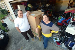R.C., left, and Stacy Davis, of Dublin, have their photo taken in front of their garage at the home they are renting in Dublin, California. Three years ago the Davis's lost their Concord condominium to foreclosure.