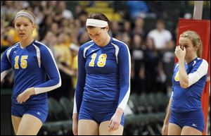 St. Ursula Academy players Elizabeth Coil, 15, Maddie Burnham, 19, and Emily Lydey, 9, walk off the court after losing to Cincinnati Ursuline during their Division I semi-final match Thursday.