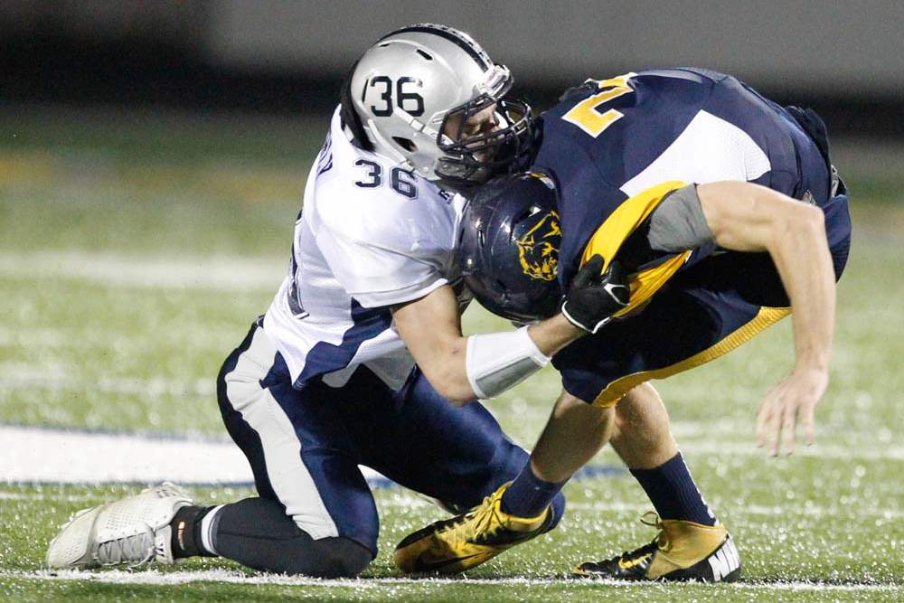 Whitmer-football-Holley-sacked