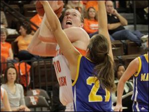 BGSU's Allison Papenfuss in the paint against MU's Michelle Lindsey in the second half.