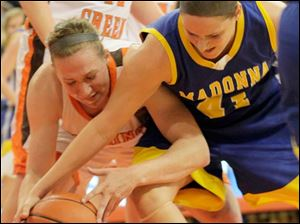 BGSU's Allison Papenfuss battles Madonna's Kaylee McGrath for the loose ball.
