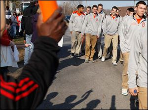 Members of the boys soccer team walk past supporters Saturday afternoon at Southview High School in Sylvania.