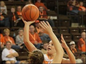 BGSU's Jillian Halfhill takes a shot over Madonna's Rachel Melcher in the second half.