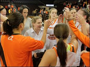 BGSU head coach Jennifer Roos speaks with her team after the win, her first as the Falcons coach.