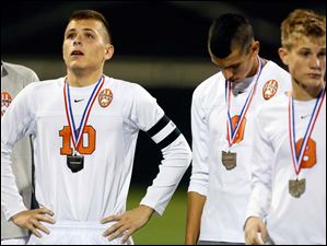 Sylvania Southview's Matt Turley (10), Omar Gad (9),, and Jeff Letcher (8) react after the match.