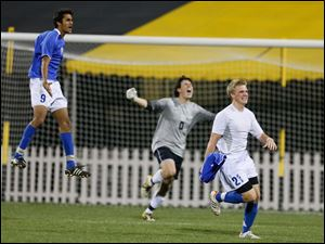 Powell Olentangy Liberty players Rajat Gupta (9), Anderson deAndrade (0), and Zach Matheny (21) celebrate winning state.