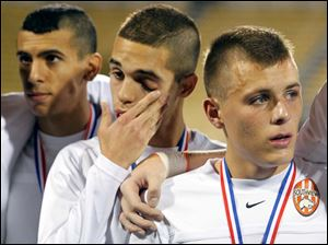 Sylvania Southview's Omar Gad (9), Samer Sarsour (12), and Matt Turley (1) react after receiving their runner-up medals.
