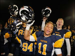 Whitmer High School player Me'Gail Frisch, 11, celebrates with teammates after the Panthers win.