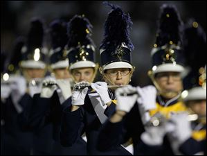 The Whitmer High School marching band plays the National Anthem before the Panthers play Hudson High School.