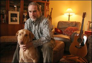 "John Grogan, author of the best selling memoir ""Marley & Me,"" poses with his new dog, Gracie, at home in Emmaus, Pa."