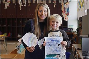Tommy Spencer, 5, holds up a few pieces of his artwork, crafted in class with his teacher, Alison Kripke, at Highland Elementary School in Sylvania. Spencer is excited to fish.