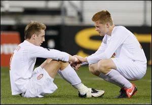 Sylvania Southview's Brad Brown (7) and Chris Ellis (16) react to the loss after the match.