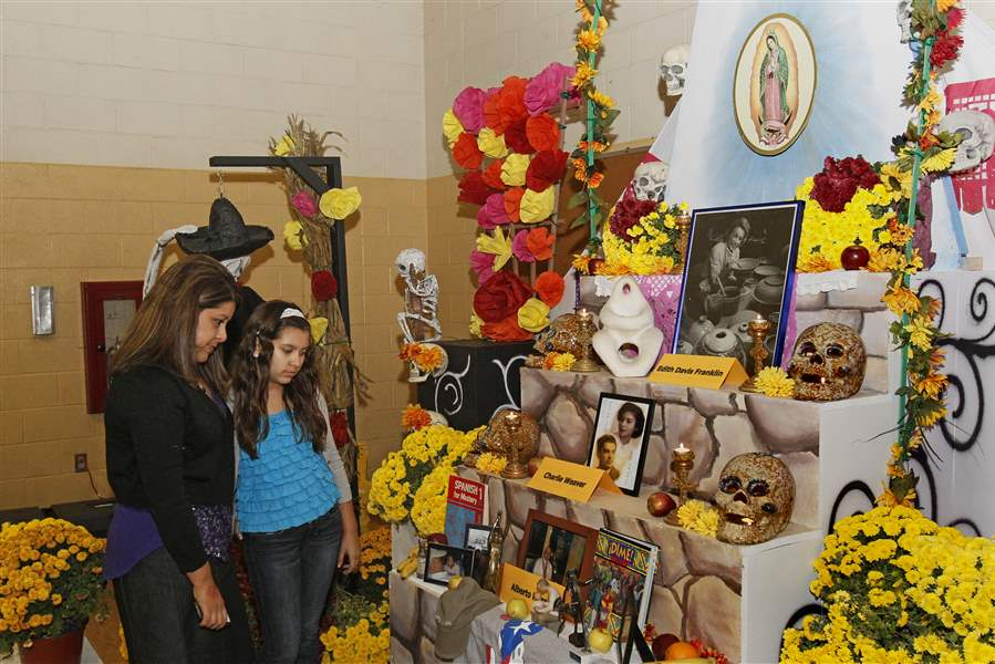Tracey-Martinez-of-Monclova-left-and-her-daughter
