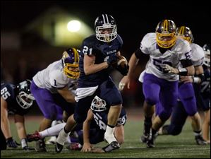 Napoleon's Max Westhoven runs the ball during the second quarter against the Golden Bears.
