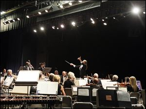 The Sylvania Community Orchestra follows the instruction of director Kathleen Hafner.