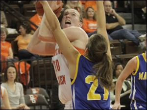 BGSU's Allison Papenfuss looks to shoot over Madonna's Michelle Lindsey. Papenfuss had a career-high 13 points win the Falcons' victory.