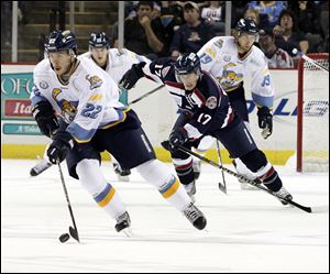 SPT walleye12p Walleye Todd Griffith is chased by the Stingrays' Tyler Johnson in the first period. The Toledo Walleye host the South Carolina Stingrays in Toledo, Ohio on November 11, 2012 The Blade/Jetta Fraser