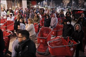 Target Corp. will open its doors at 9 p.m. on Thanksgiving, three hours earlier than a year ago, to kick off the holiday shopping season. The discounter joins several other major retailers, including Wal-Mart Stores Inc., that are opening earlier in the evening on the holiday and staggering deals over the two-day period.