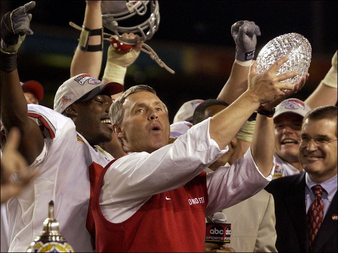 Coach Jim Tressel and Ohio State celebrated a BCS championship with a 31-24 double-overtime victory against Miami in January, 2003. That team will be honored Nov. 24 in Columbus.