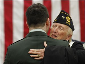 Purple Heart recipient Matt Drake is hugged by retired Army Col. and Maumee resident Diana French.