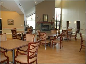 The Our Lady of Grace Common Area is a dining area and sitting area with fireplace.