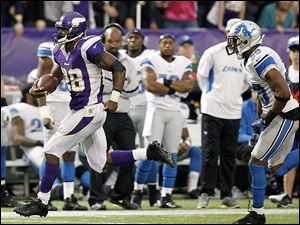 Vikings running back Adrian Peterson eludes Lions safety Ricardo Silva to score on a 61-yard touchdown run in the second half on Sunday. He finished with 171 yards rushing.