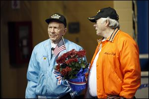 Korean War Veteran Henry Bahler, left, talks with Vietnam Veteran Attison Digby after the Veterans Appreciation Breakfast and Resource Fair in Savage Arena at the University of Toledo.