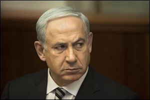 Israeli Prime Minister Benjamin Netanyahu attends the weekly cabinet meeting in his Jerusalem office, Sunday, Nov. 11, 2012. Netanyahu says his country is ready to strike harder against Gaza Strip militants if they don't stop attacking Israel. (AP Photo/Sebastian Scheiner, Pool)