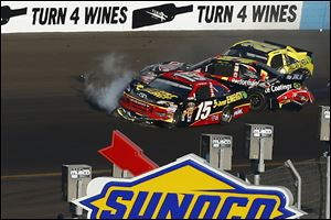 From left, Clint Bowyer (15), Jeff Gordon and Joey Logano crash in Turn 4 during the NASCAR Sprint Cup Series race at Phoenix International Raceway.