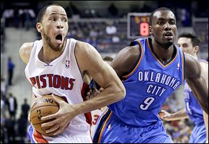 The Pistons' Tayshaun Prince (22) drives on the Thunder's Serge Ibaka (9). Detroit kept the game close and led for most of the contest but fell to 0-8 this season.