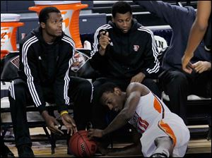BGSU's Craig Sealey dives under the bench chairs to chase a loose ball.