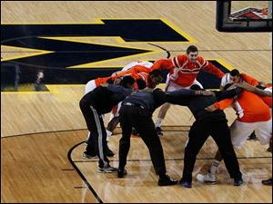 BGSU huddles on the UM court before the start of the NIT Seasonal Tip-Off North Regional game against IUPUI  at Crisler Arena at the University of Michigan in Ann Arbor, Mich.