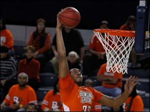 Cleveland State's Anton Grady watches as BGSU's Cameron Black attempt a dunk during 2nd half.