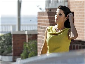 Jill Kelley is identified as the woman who allegedly received harassing emails from Gen. David Petraeus' paramour, Paula Broadwell. She serves as an unpaid social liaison to MacDill Air Force Base in Tampa, where the military's Central Command and Special Operations Command are located.