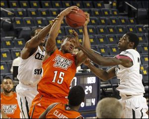 BGSU's A'uston Calhoun pulls down a defensive rebound from Cleveland State during NIT game at Crisler Arena at the University of Michigan in Ann Arbor, Mich.