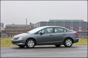 The 2012 Honda Civic LX sedan has drawn complaints that its design lacks pizazz, even though sales are strong. Next year's model looks more sporty. Driving characteristics are changing, too.