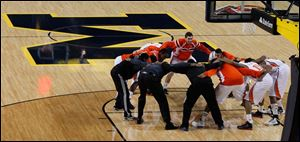 The Falcons huddle up on the floor of the Wolverines today prior to the start of their game against IUPUI.