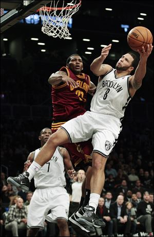 Brooklyn Nets' Deron Williams drives past Cleveland Cavaliers' Alonzo Gee during the first half tonight in New York.